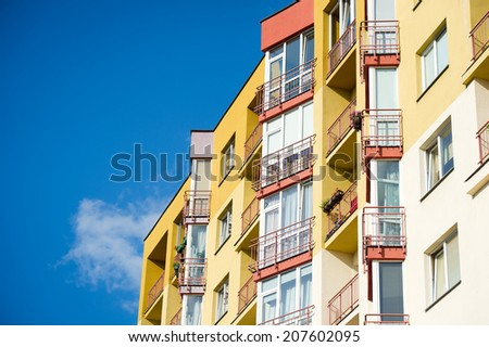 Modern and new apartment building. Multistoried, modern, new and stylish living block of flats. Real estate. New house. Newly built block of flats. - stock photo
