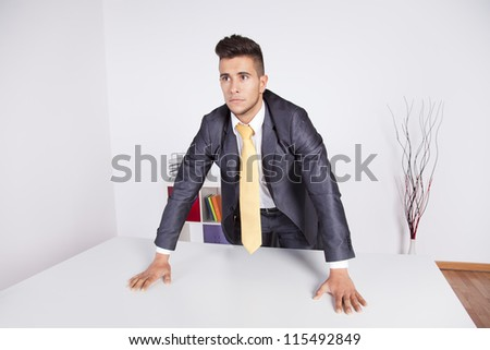 Modern and powerful businessman at his office - stock photo