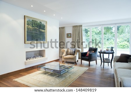 Modern and spacious living room with porch view - stock photo