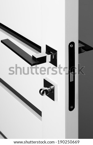modern and stylish black with white door lock - stock photo