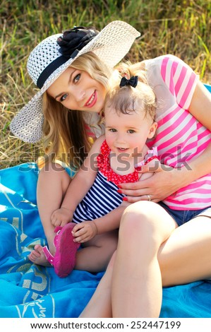 Modern and young mother with baby - stock photo