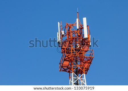 Modern antenna with flat parabola on blue sky