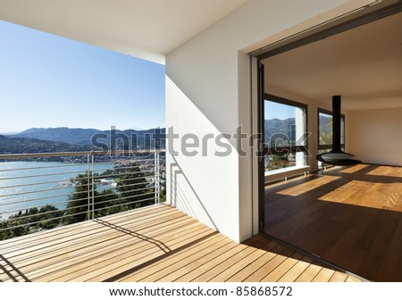 Modern apartment, balcony with panoramic view - stock photo