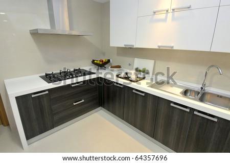 Modern apartment big kitchen with beautiful decoration - stock photo