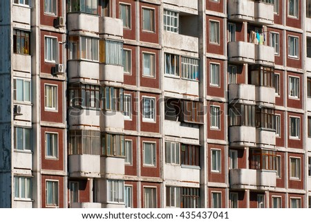 Modern apartment building. Front view. Divercity of windows.