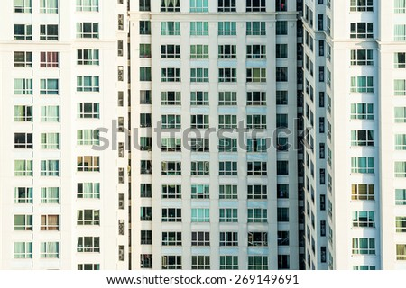 Modern apartment building isolated in the sunlight, Saigon, Vietnam - stock photo