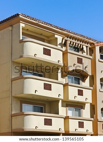 Modern apartment building with balconies - stock photo