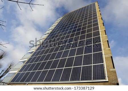 Modern apartment building with solar panels - stock photo