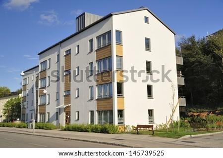 Modern apartment buildings in new neighborhood.  - stock photo