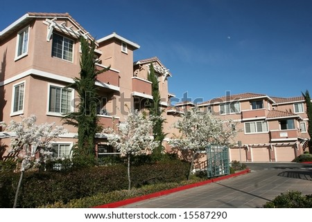 Modern apartment buildings on a sunny summer day - stock photo
