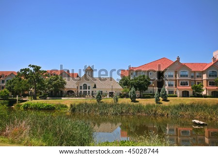 Modern apartment complex (condo) with pound and walking pass 1 - stock photo