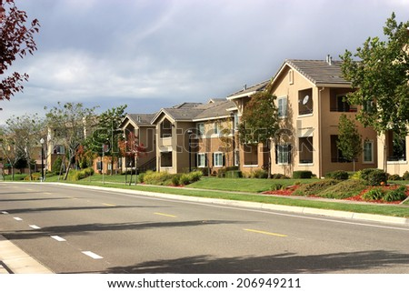 Modern apartment complex in suburban neighborhood - stock photo
