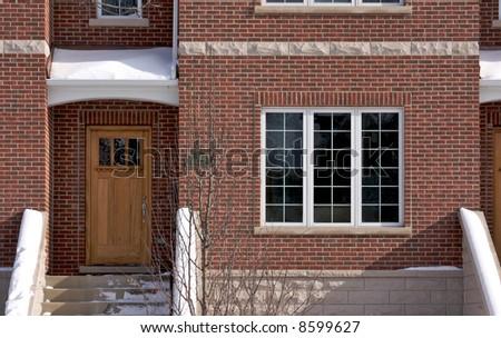 Modern Apartment Facade on a Snowy Winter Day - stock photo