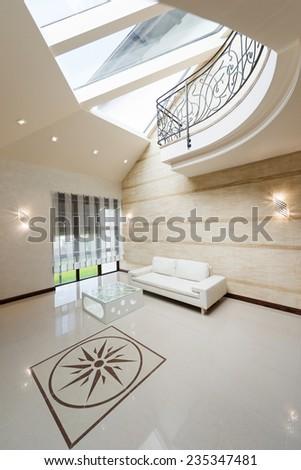 Modern apartment hall interior with white sofa - stock photo