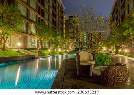 Modern apartment houses with swimming pool - stock photo