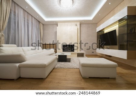 Modern apartment interior with fireplace - stock photo