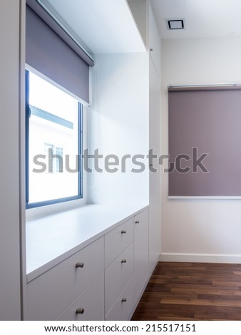Modern apartment interior with walk in wardrobe - stock photo
