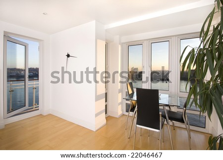 Modern apartment overlooking river, London - stock photo