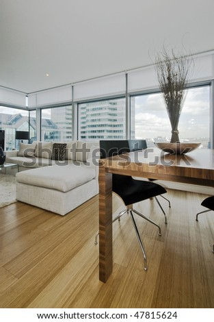 modern apartment with floor to ceiling windows and city views - stock photo