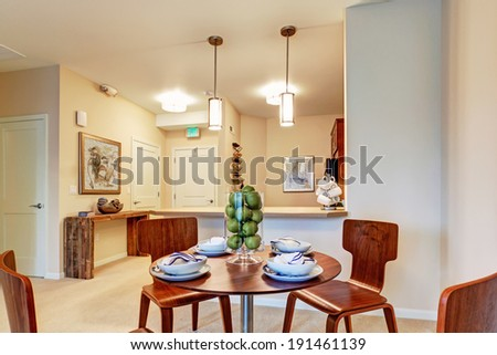 Modern apartment with open floor plan. View of served dining table in dining area - stock photo