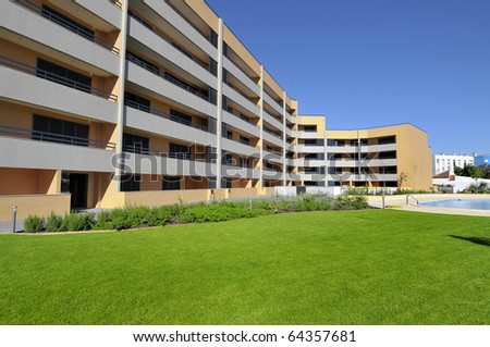Modern apartments outdoors view with swimming pool - stock photo