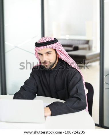 Modern arabic businessman on office working on laptop - stock photo