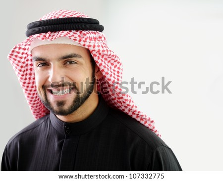 Modern Arabic businessman showing clean and healthy teeth - stock photo