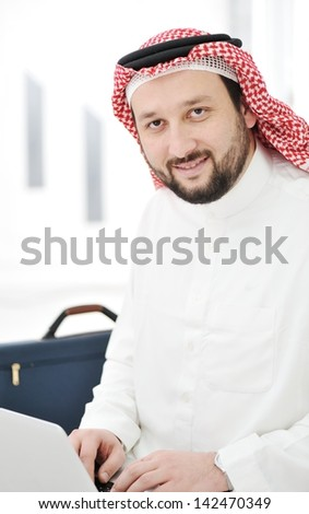 Modern arabic businessman with laptop