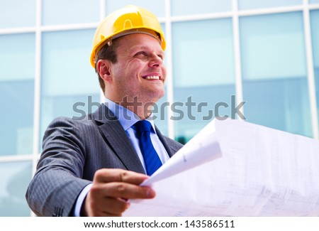 Modern architect looking on design plans