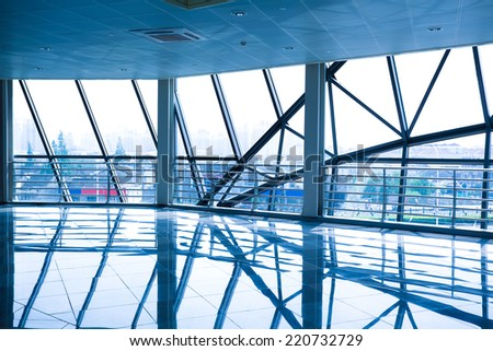 Modern architecture at glass wall corridor backgrounds - stock photo