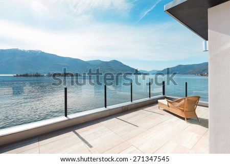modern architecture, beautiful lake view from the terrace of a penthouse - stock photo