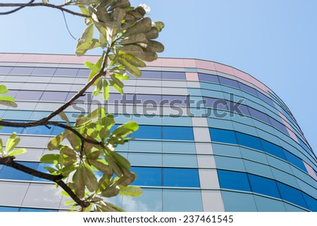 Modern architecture, colored stripes around curtain glass exterior wall - stock photo