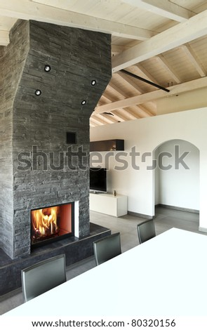modern architecture contemporary, interior, dining table and fireplace - stock photo