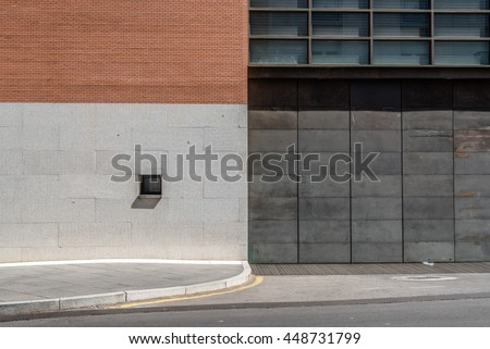 Modern architecture door and window in a facade made of stone, brick and steel. Abstract design.