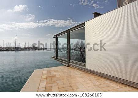 modern architecture in a building surrounded by water - stock photo