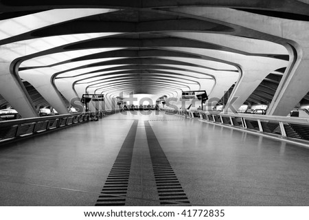 Modern Architecture: Long Passage Way at Train Station at Saint-Exupery Airport, Lyon, France - stock photo