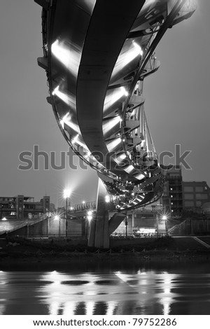 Modern architecture of bridge in night in black and white, landmark in Taipei, Taiwan. - stock photo