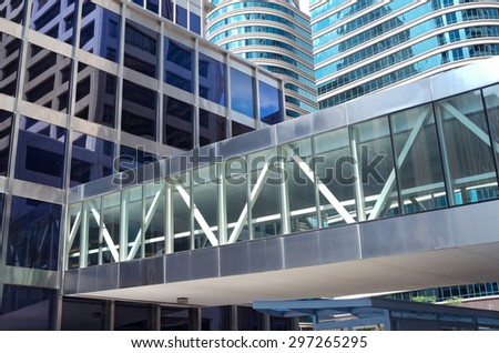 modern architecture of glass skyscrapers and reflections in windows with skyway over street in downtown minneapolis - stock photo