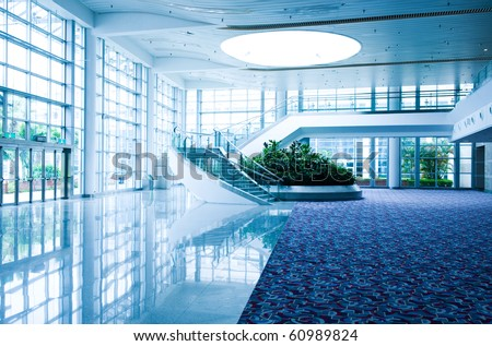 Modern architecture of large business conference center with blue tone. - stock photo