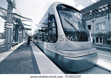 Modern Architecture of light rail station with train metro - stock photo