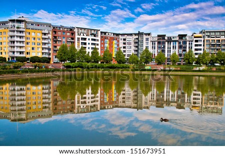Modern architecture with reflection in as lake in Berlin in Germany  - stock photo