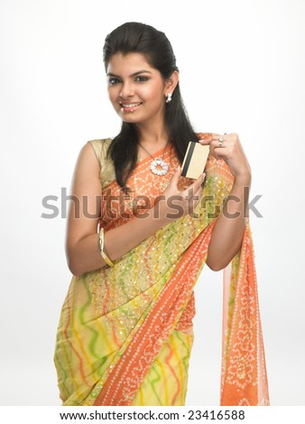 Modern asian girl in sari with the  credit card - stock photo