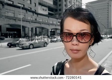 Modern Asian woman walking on street of Taipei, Taiwan, Asia. - stock photo