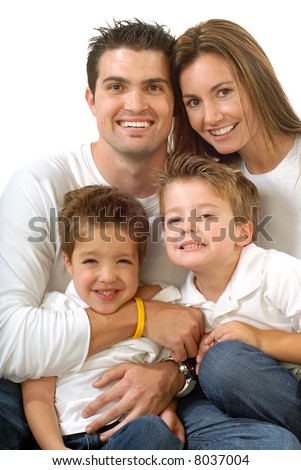 Modern, attractive young family hugging and laughing together - stock photo