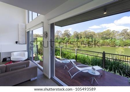Modern Australian living room overlooking the river - stock photo