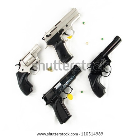 Modern automatic handgun pistols and revolvers with bullets isolated on white background - stock photo