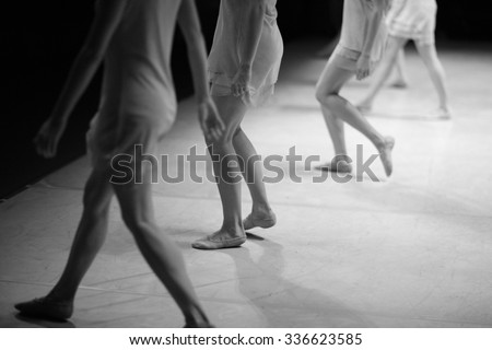 Modern ballet dance performance, low section of dancers on stage - stock photo