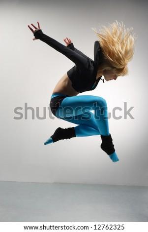 modern ballet dancer dancing on the grey studio background - stock photo