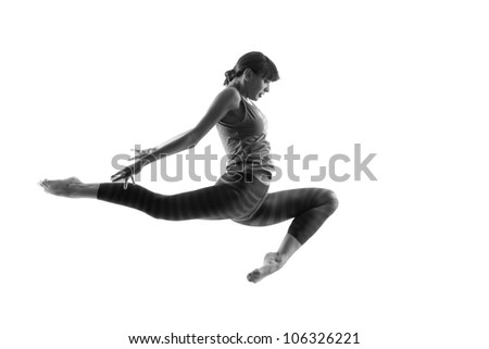 modern ballet dancer dancing on the white studio background - stock photo