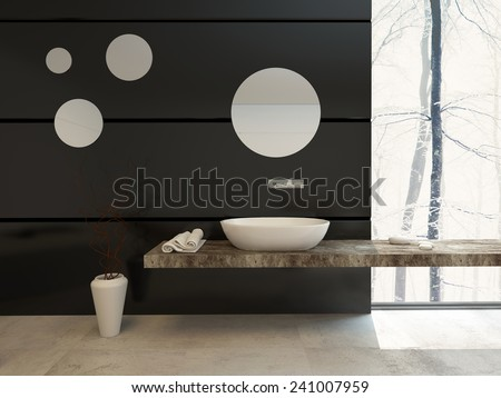 Modern bathroom decor on a black wall with a wall-mounted hand basin below a round mirror over a beige tiled floor with a large view window letting in daylight - stock photo